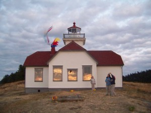 Lighthouse docents kite flying at sunset