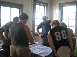 Docents explain a map of the area